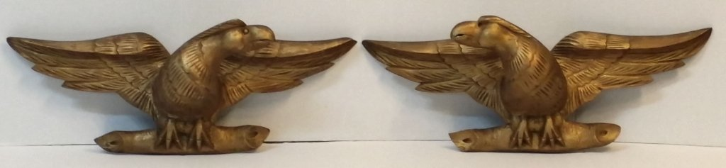 A Pair of gold painted carved eagles