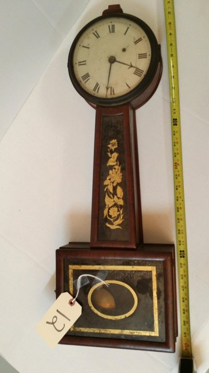 An antique Banjo clock, as is glass.