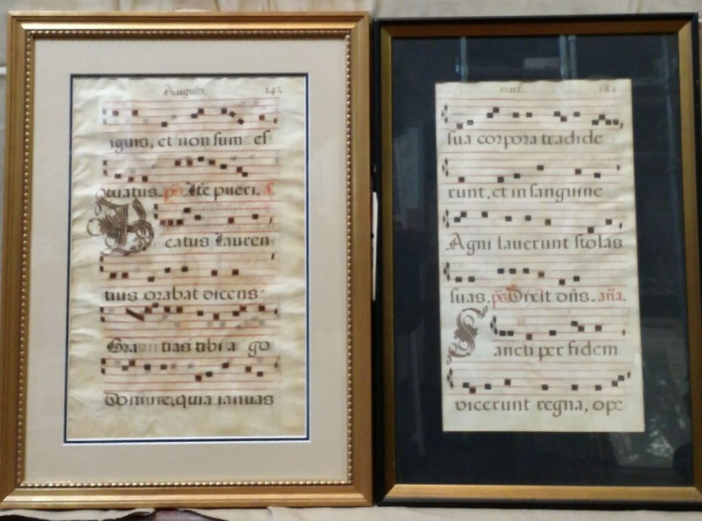A pair of antique hand written Latin musical pages