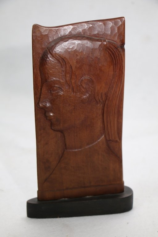 A Carved wooden 2 sided carving