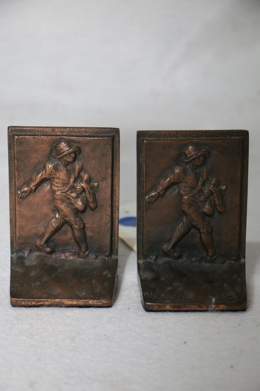 A pair of small antique bookends