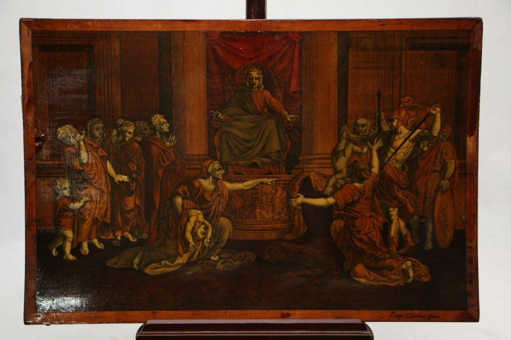 An antique carved and inlaid wood panel