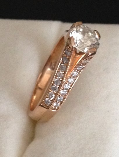 14 kt gold AGI G color, S12 clarity certified diam