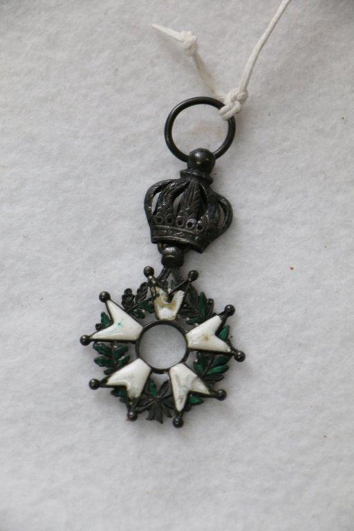 A vintage enameled medal