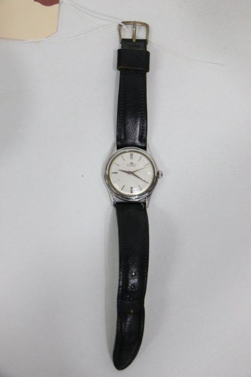 A Gent's Bucherer Stainless Wristwatch