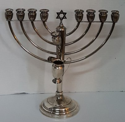 A Sterling Silver Menorah With Oil pitcher