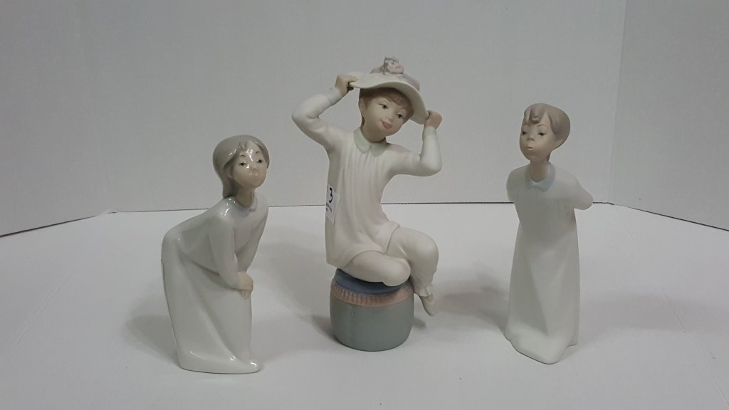 Lladro Boy & Girl Kissing with Girl Clutching Hat