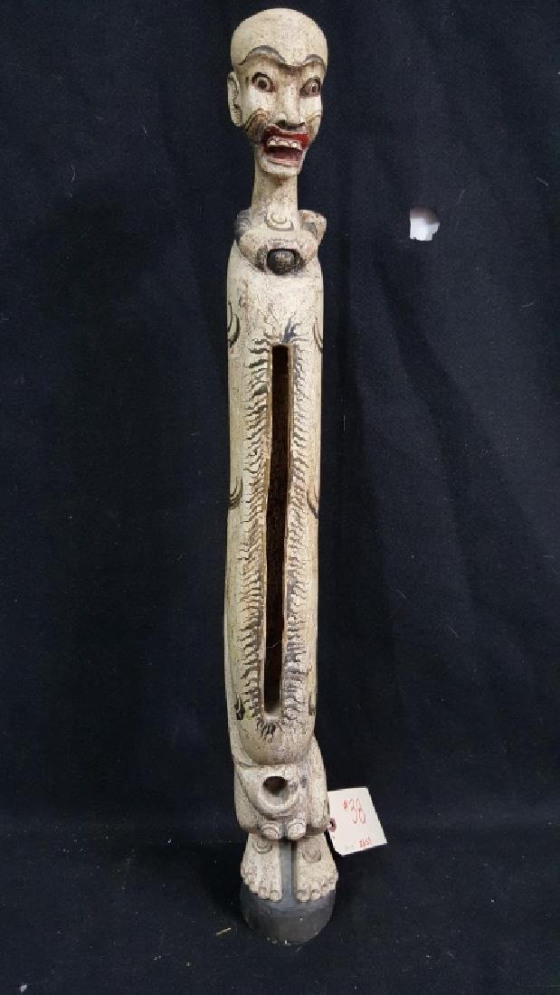 Carved Indonesian Figure. Drum figure