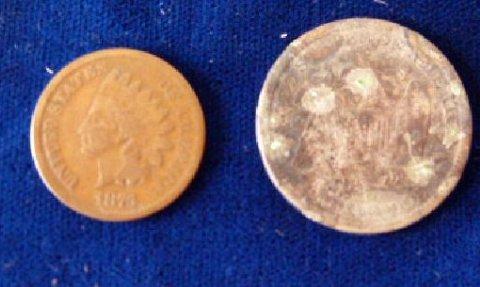 2 AMERICAN COINS INCL.1877 CC QUARTER DOLLAR