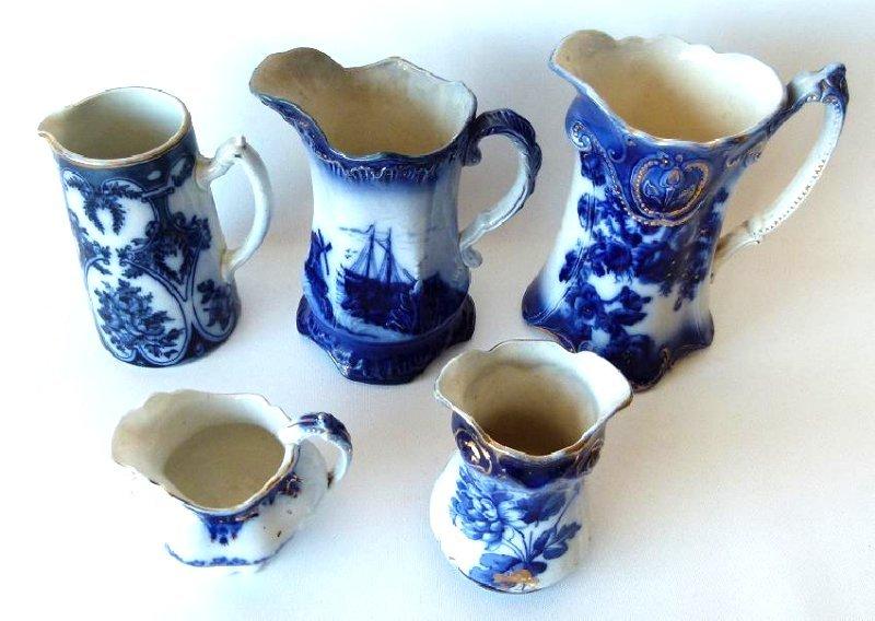 LOT (5) ASSORT FLOW BLUE MILK PITCHERS, 19TH C.