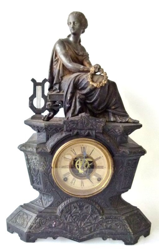 VICTORIAN CAST IRON FIGURAL SHELF CLOCK W/ SIGNED