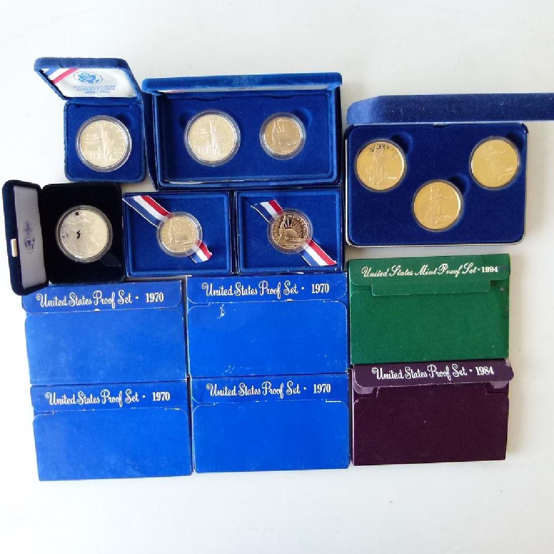LOT (12) CASED SETS US COINS