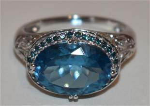 CONTEMPORARY 14KT WHITE GOLD/BLUE TOPAZ RING, 20TH C.