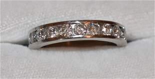 FINE MODERN UNISEX PLATINUM/DIAMOND RING W/ .90 CT DIAM