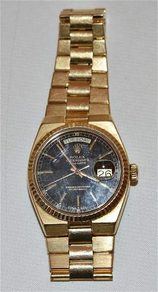 EXCEPTIONAL 18KT YW. GOLD ROLEX DAY/DATE OYSTERQUARTZ