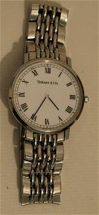 TIFFANY & CO. S/STEEL THIN LINE WRIST WATCH, C. 1990