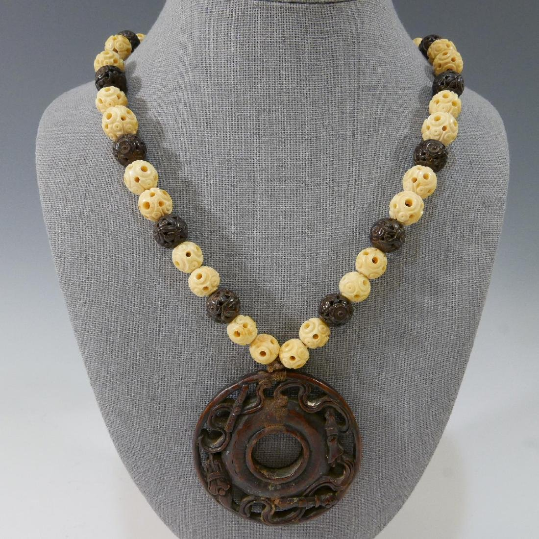IMPRESSIVE ANTIQUE CARVED ALOESWOOD AND WHITE BEADS
