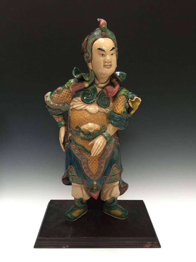A CHINESE ANTIQUE POLYCHROME DECORATED FIGURE