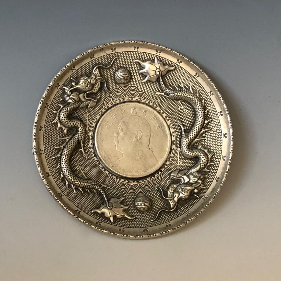 CHINESE SILVER COIN SET IN DRAGON PLATE