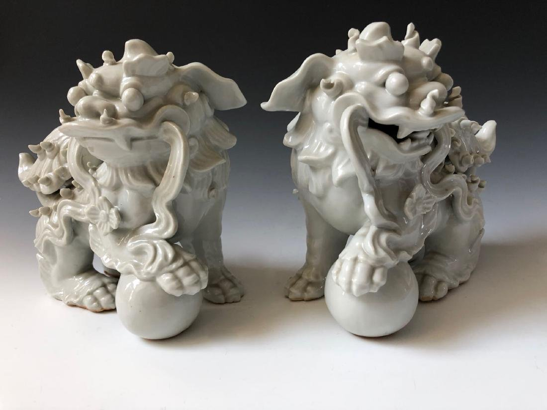 A PAIR OF CHINESE ANTIQUE WHITE GLAZED LIONS - 4