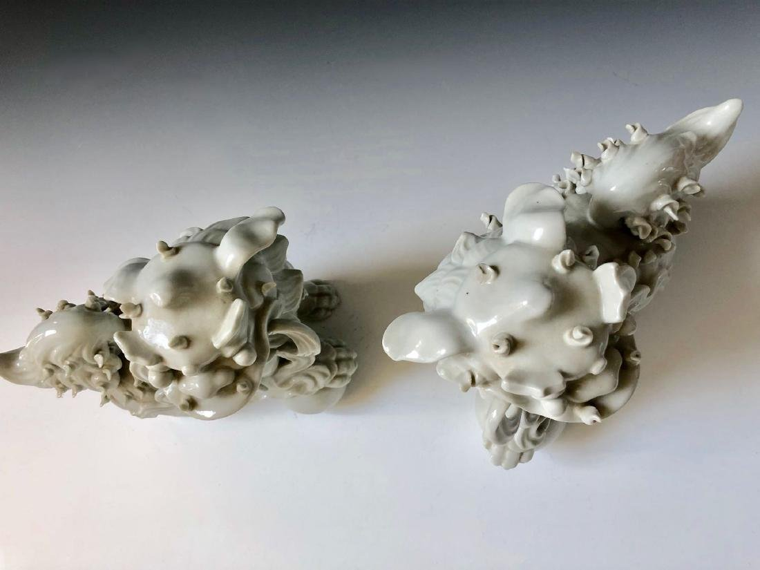 A PAIR OF CHINESE ANTIQUE WHITE GLAZED LIONS - 5