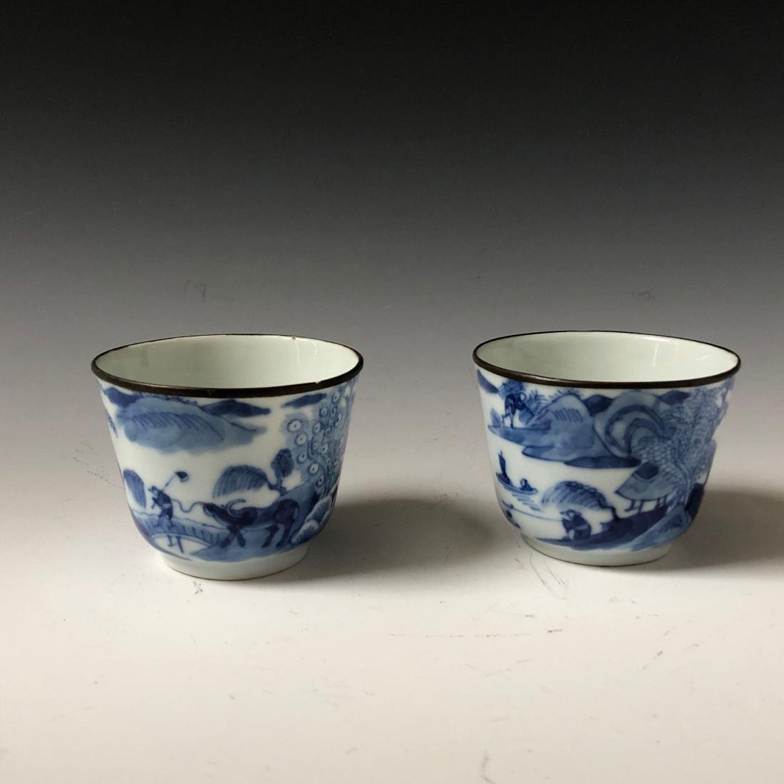 A PAIR OF CHINESE ANTIQUE BLUE AND WHITE CUPS , MARKED. - 2