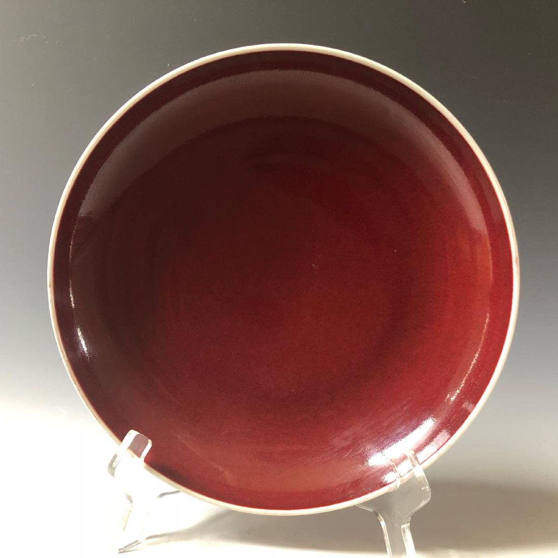 A CHINESE ANTIQUE COPPER-RED-GLAZED PLATE WITH GUANXU