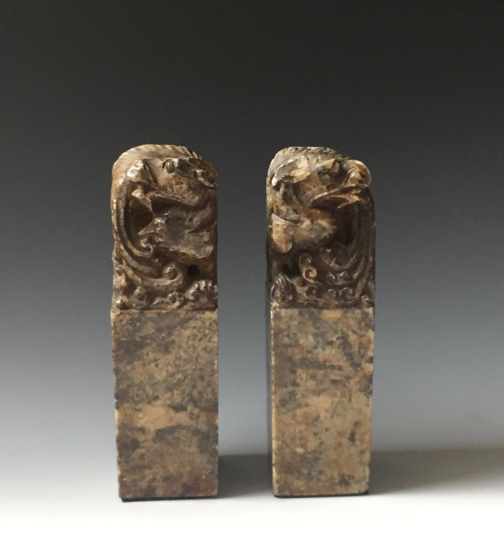 A PAIR OF ANTIQUE CARVED SOAPSTONE DRAGAN SEAL
