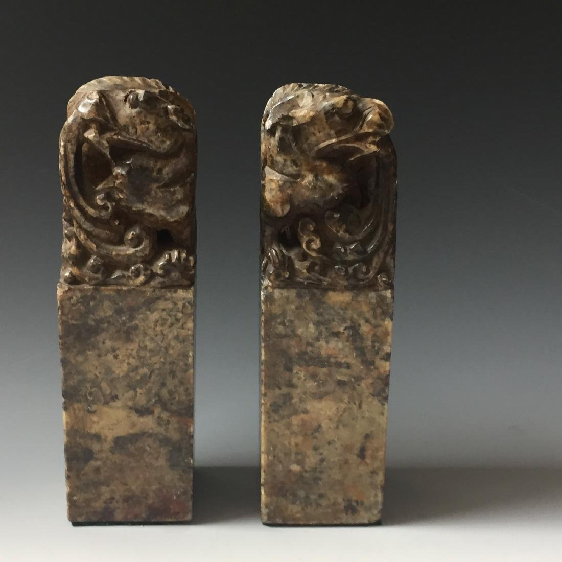 A PAIR OF ANTIQUE CARVED SOAPSTONE DRAGAN SEAL - 2
