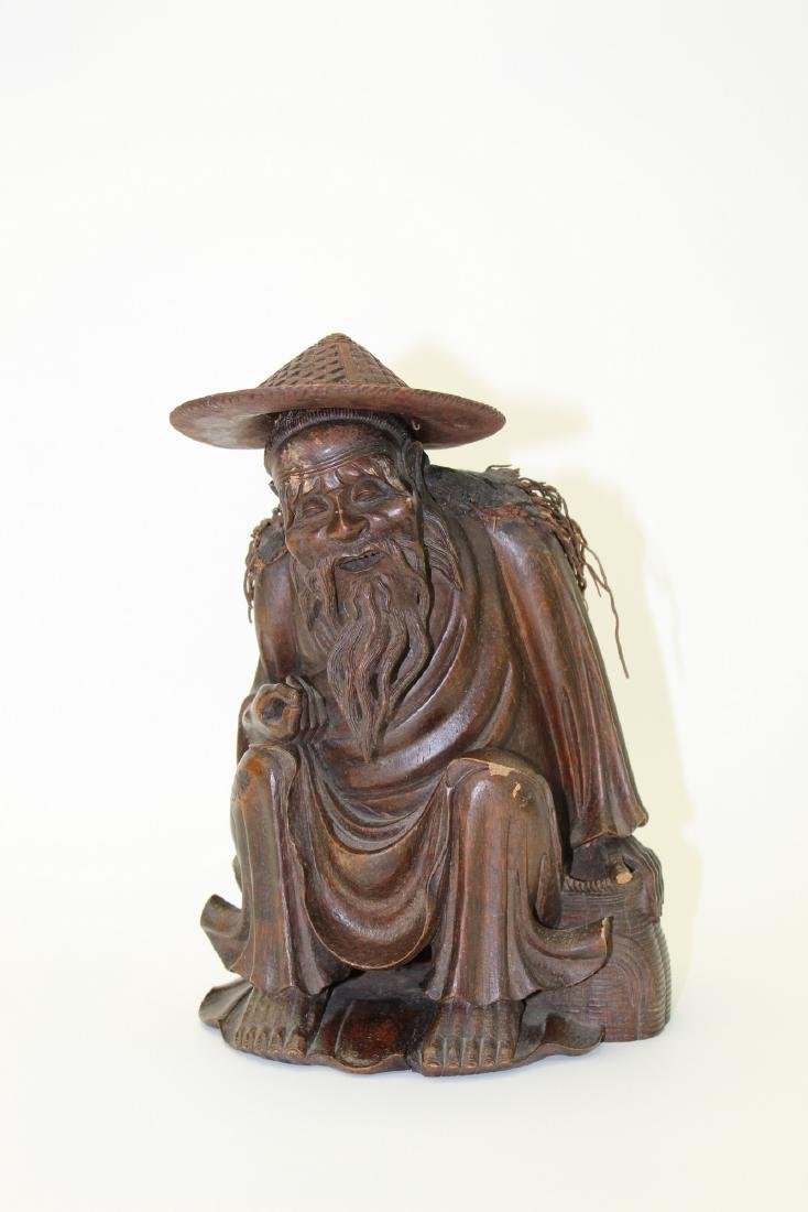 Chinese carved wood fisherman