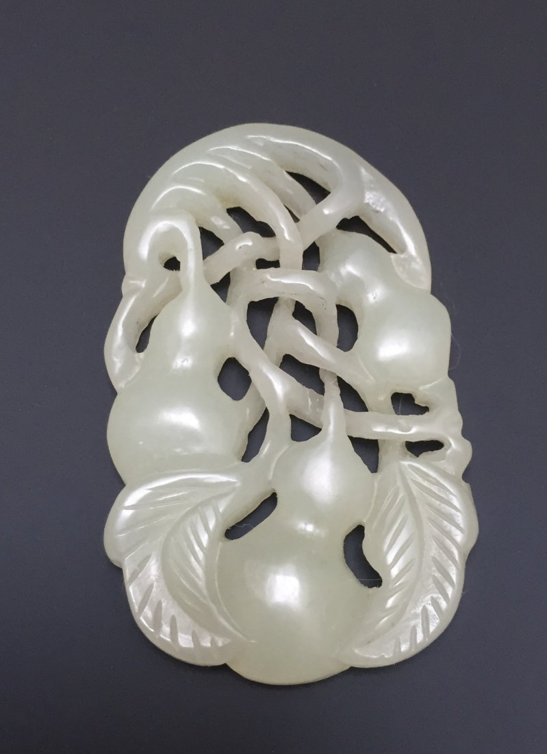 A WHITE JADE PENDANT 18TH OR 19TH CT
