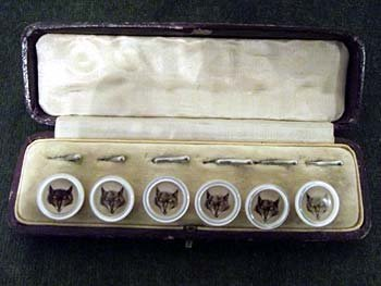 A cased set of six hunt buttons, with circular mother-o
