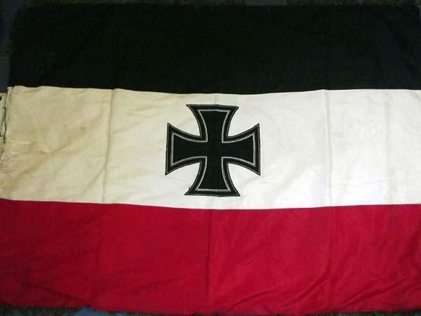 A 1913 German flag, framed on edges by gilt thread tass