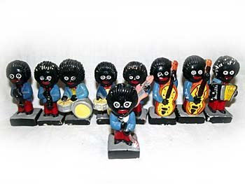 A collection of Robertsons plaster golliwogs'- two drum