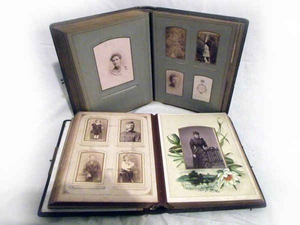 Two leather bound Victorian embossed albums containing