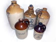 Five saltglazed stoneware spirit jars including a 1932