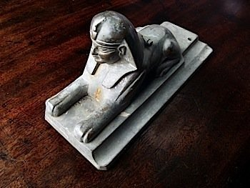 A regency bronze inkwell cast as a sphinx, with pentray