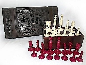 A stained ivory chess set with ring-turned slender piec