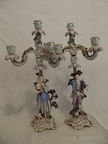 A pair of Meissen candelabra, each having three scrolle