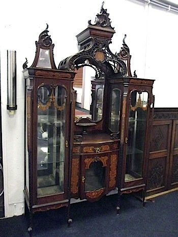 A Chinese style rococo display cabinet, with scroll car