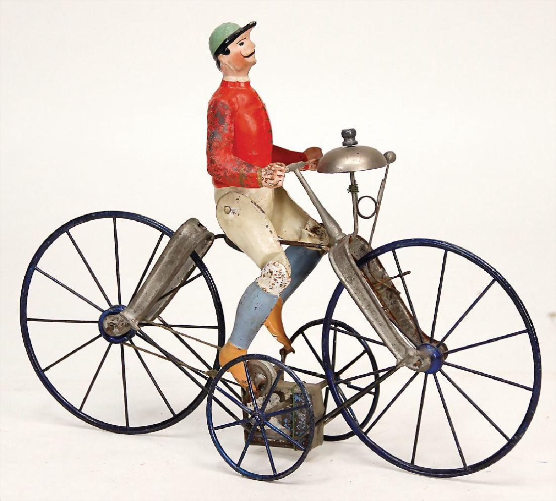 cyclist, handpainted sheet metal, around 1900, 30.5 cm,