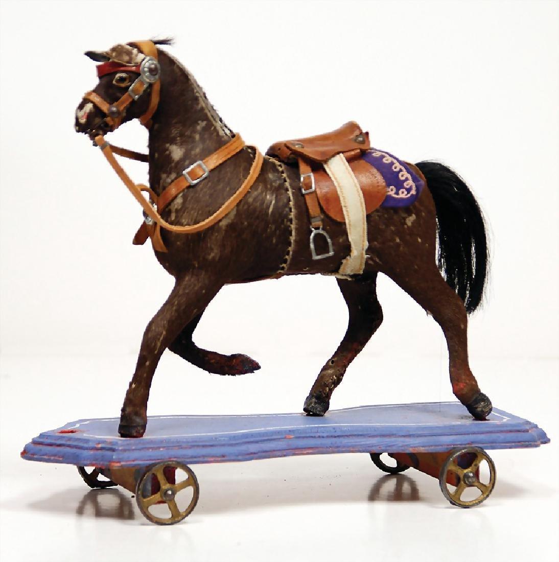 early draft horse, pelt covered, original saddle,
