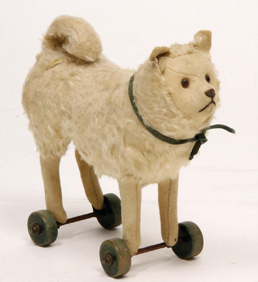 STEIFF dog, spitz, on wooden wheels, mohair with felt,