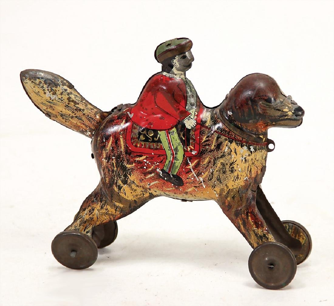 PENNY TOY dog with rider, lithographed, 11.5 cm,