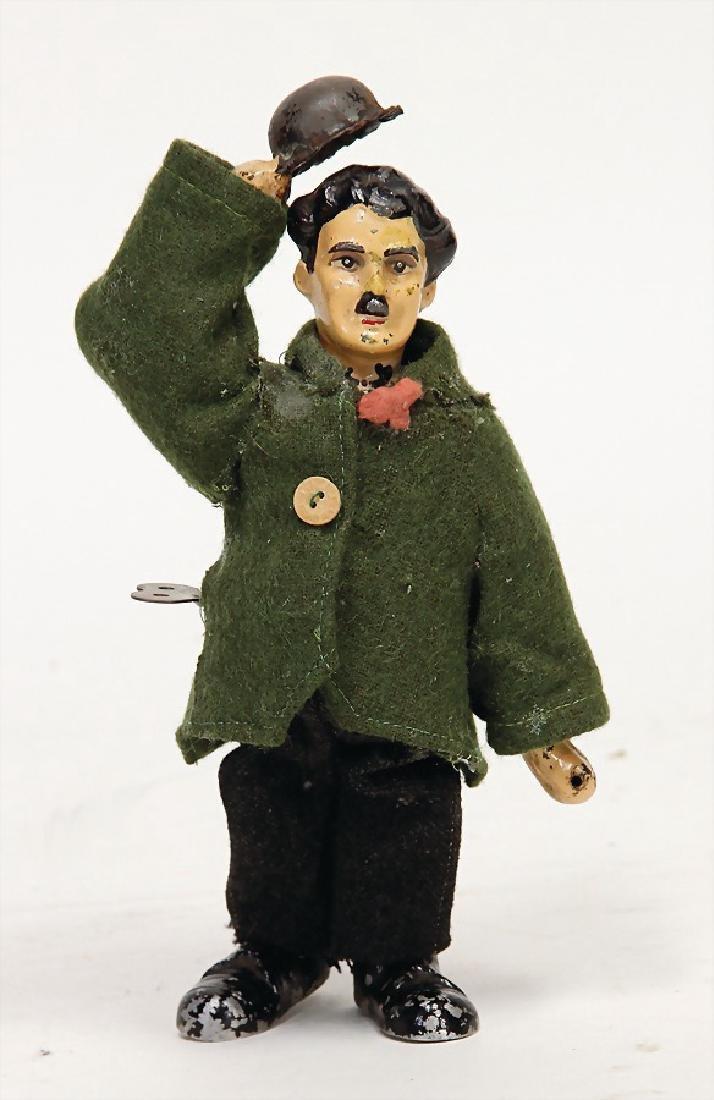 Charly Chaplin, clock mechanism toy, metal casting,
