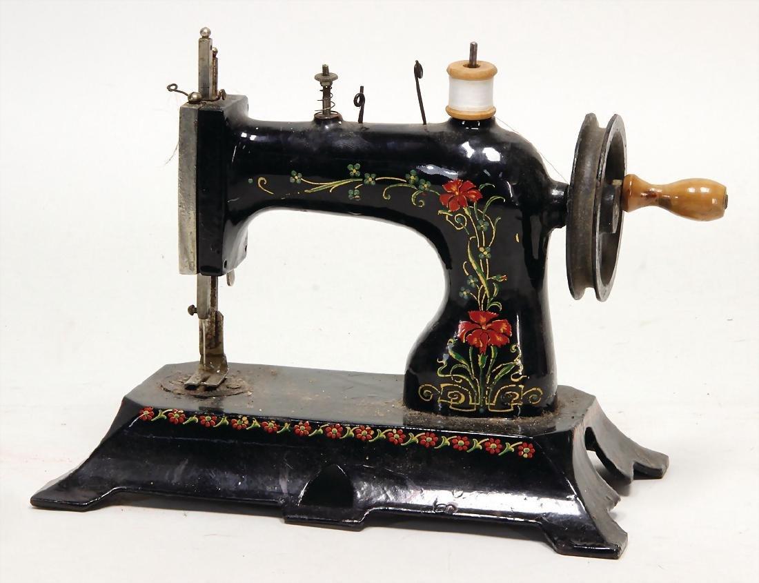 children's sewing machine, heavy tin construction, 25.5