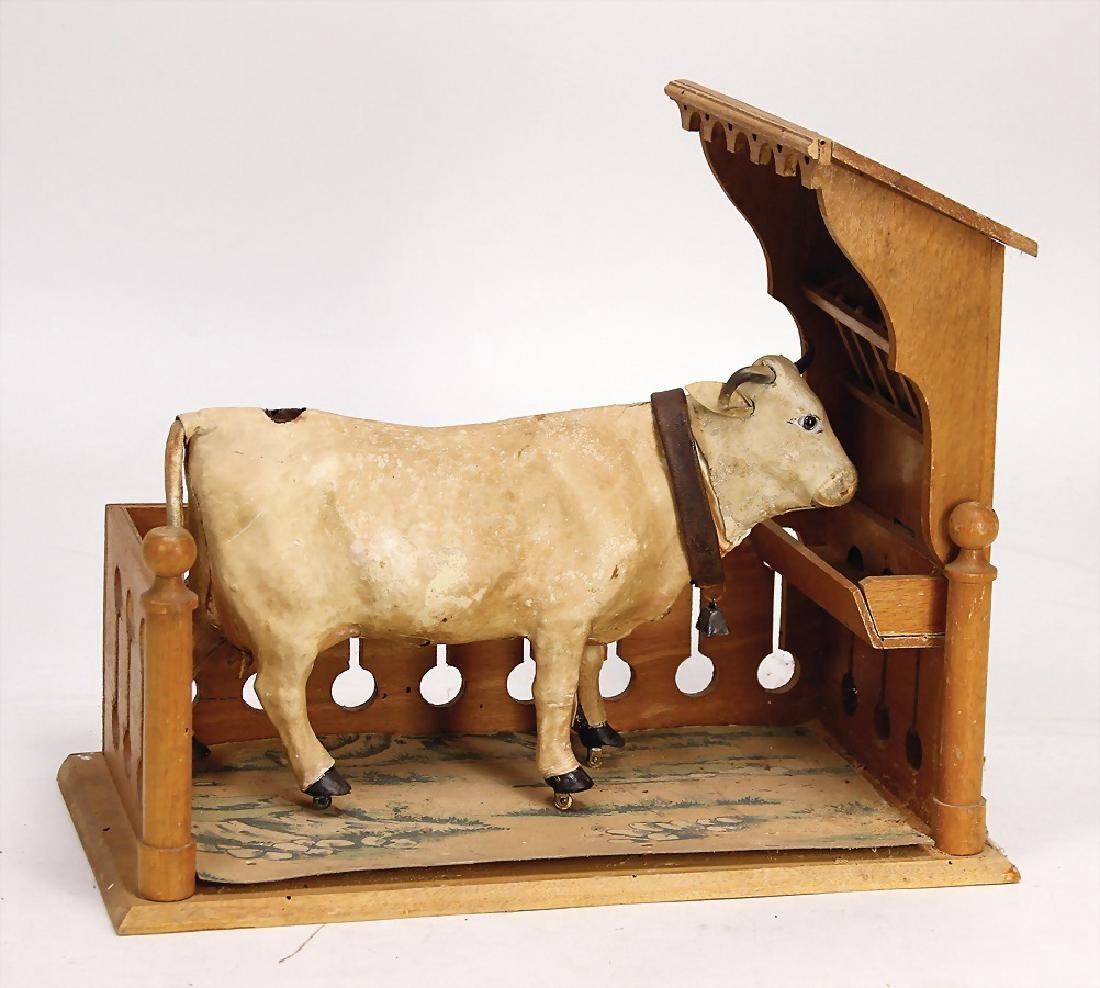 cow, c. 1890, leather covered, glass eyes, with water