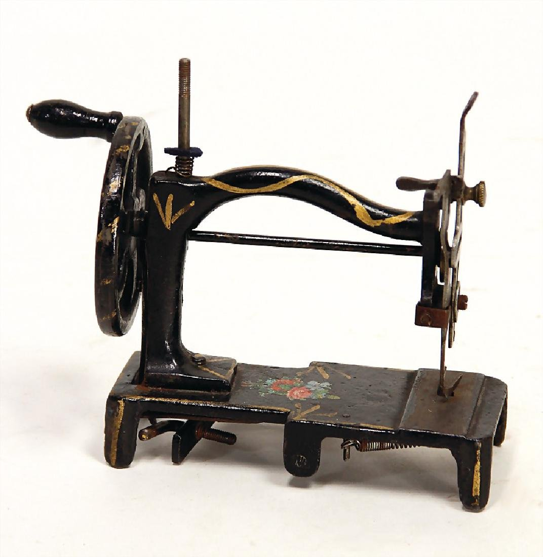 early children's sewing machine, iron casting,
