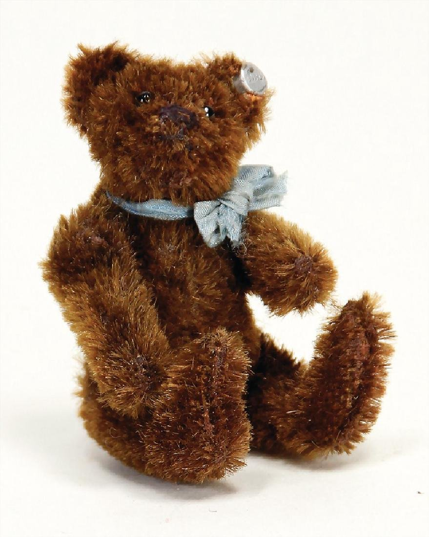 STEIFF bear, dark-brown, with button, long stretched f,