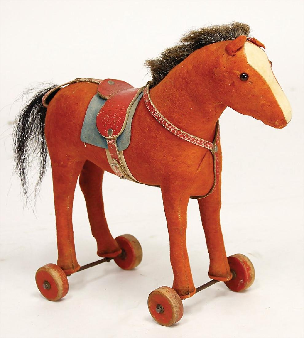 STEIFF horse on wooden wheels, '30s, height: 24 cm,